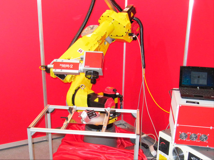 Metalworking exhibition of 2014/ Laser marking system integrated into a robotic complex.