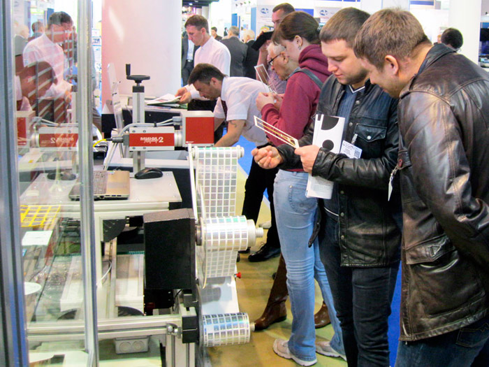 Photonics exhibition of 2014. Expo. Samples laser marking including bar-codes and Qr-codes.